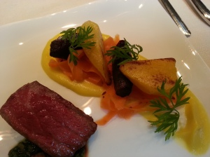 Medium rare Hida beef on a jalapeno sauce with roast vegetables on a cumin carrot puree