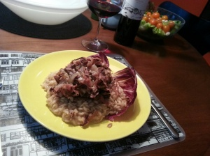 You saute onion and pancetta, then braise radicchio.  Set aside.  Make risotto.  Top with radicchio.  Heaven.