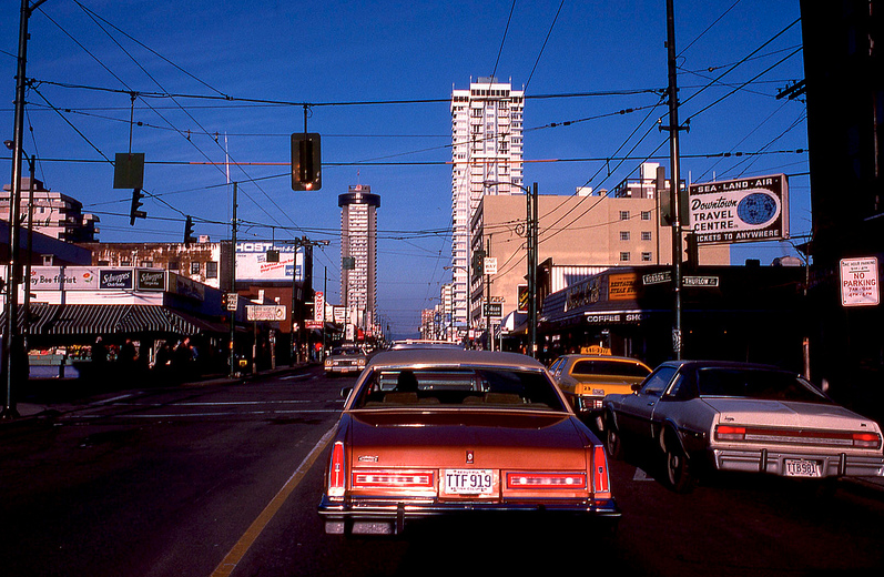 Robson St in the late 1970s, at the end of its heyday, when you could still get groceries, a magazine and even drop your shoes off at a cobbler.